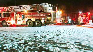 PHOTOS: Firefighters battle flames in icy conditions