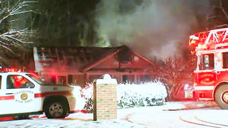 Charlotte firefighters battle raging house fire in freezing conditions