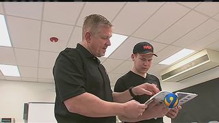 Mentor program uses scuba diving to keep students on track