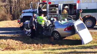 Firefighters rescue woman pinned in car after crash with cement truck