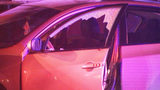 Two men sitting in car shot during attempted robbery, police say