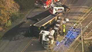 Overturned dump truck shuts down busy Pineville road