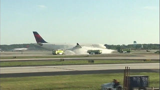 VIDEO: Firefighters douse commercial airliner after reports of smoke from engine