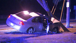Portion of South Tryon Street blocked after car slams into power pole
