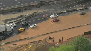 Clogged drains cause flooding on major interstate