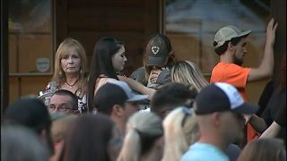 Community holds vigil after man crashes into restaurant, killing 2