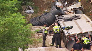 2 dead after tractor-trailer crashes down runaway truck ramp, troopers say