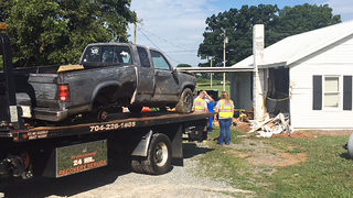 Truck lands on propane tank after crashing into Union County home
