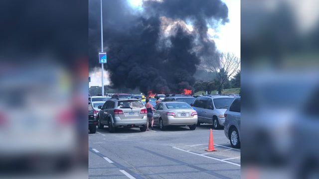 PHOTOS: Multiple vehicles catch fire in Carowinds parking lot | WSOC-TV