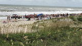 Beachgoers form human chain to pull people out of water at Emerald Isle