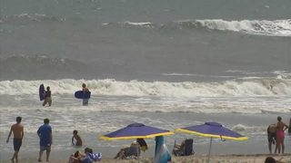 Four swimmers pulled from rough waters off Emerald Isle; one unconscious