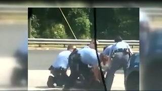 North Carolina police charge man officers struck with baton
