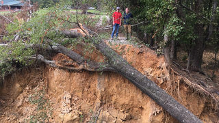 Family trapped for days after dam breach washes out road