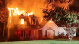 Flames rip through Mount Holly home