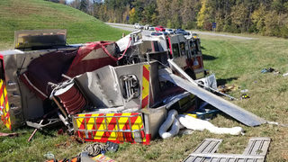 Fire truck rolls over in wreck on way to emergency