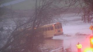 IMAGES: Crews work to pull school bus from floodwaters in Cabarrus County