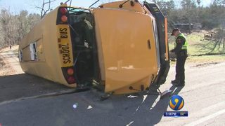 Driver charged with 19 counts of child abuse after causing school bus crash, officials say