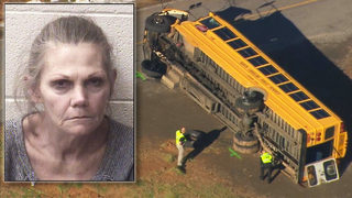 Woman charged with 2 counts of child abuse after causing school bus crash, officials say