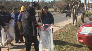 Volunteers clean up busy Charlotte road as part of worldwide initiative