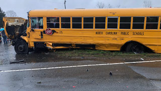 Pickup truck driver charged after allegedly causing school bus wreck