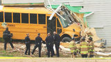 MEDIC: No major injuries after school bus crashes into building in north Charlotte