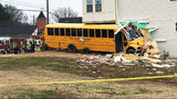 WATCH: Video shows school bus crashing into car before plowing into townhouse