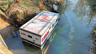 Armored truck crashes into Long Creek in northwest Charlotte