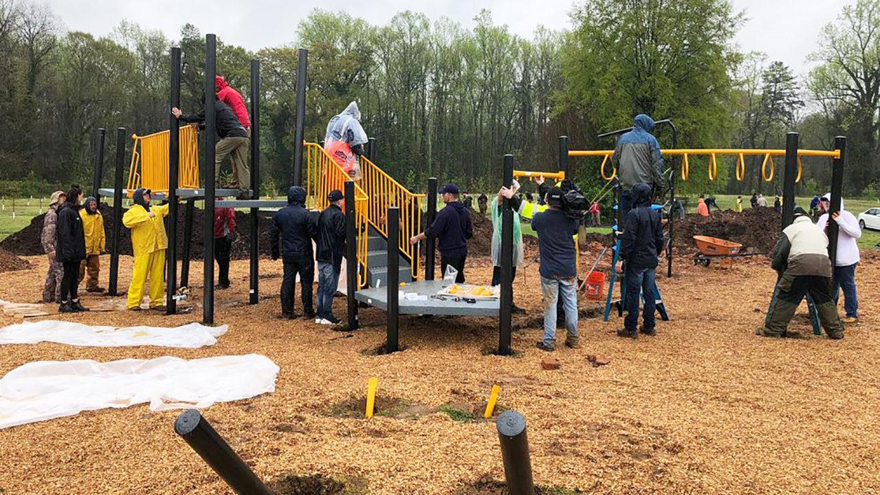 290e9eac76b5 VOLUNTEERS BUILD NEW PLAYGROUND  Volunteers rally in rain to build ...