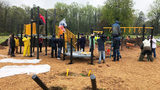 Volunteers rally in rain to build new playground for west Charlotte school