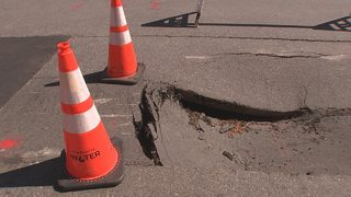 Two forming sinkholes close busy uptown street; construction extended to next Friday