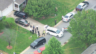 Investigators in hazmat suits called to Mooresville home where 2 men died