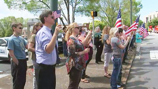 Hundreds line streets as heroic UNCC students