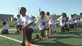 Panthers legend hosts football camp for 700 kids
