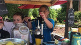 Sisters sell lemonade to help pay off classmates' school lunch debt