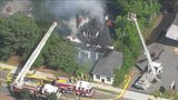 Firefighters work to put out large house fire in Mooresville