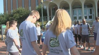 Hospital employees honor UNC Charlotte shooting victims at walk
