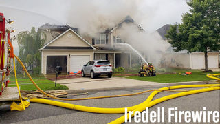 MOORESVILLE HOUSE FIRE: Firefighters battle flames that rip