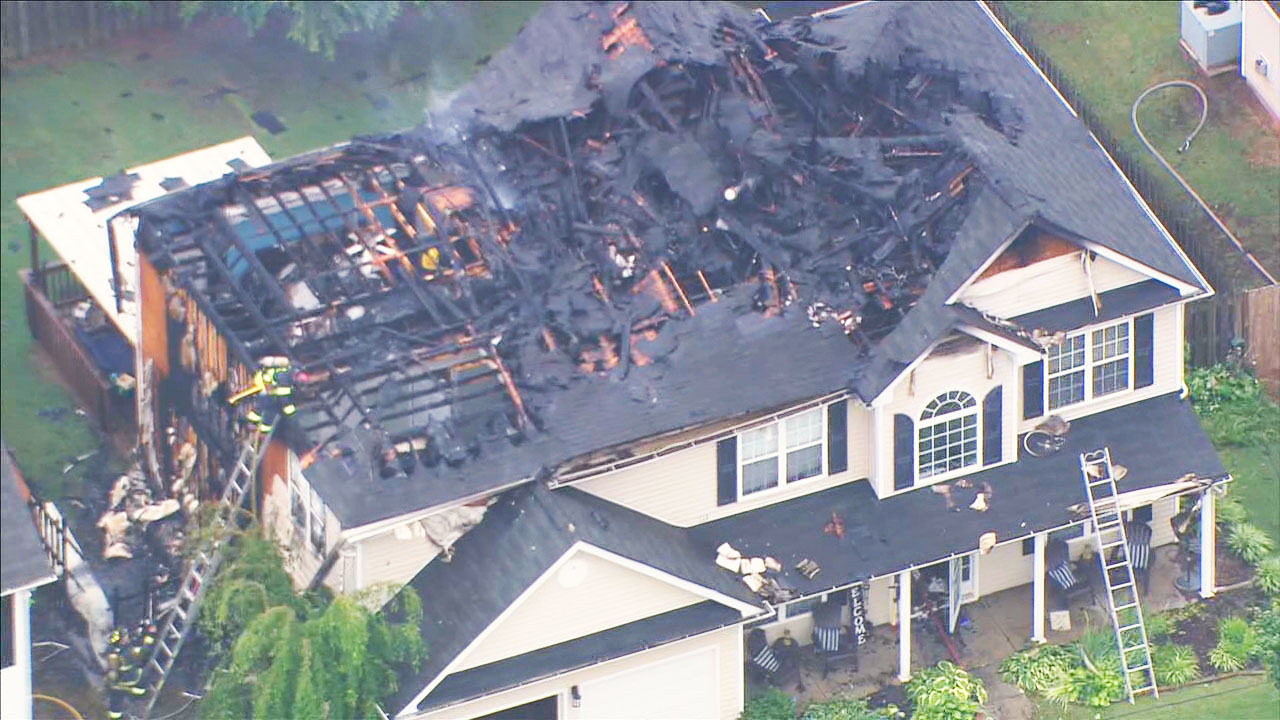 MOORESVILLE HOUSE FIRE: Firefighters battle flames that rip through