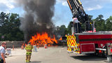 Emergency crews investigating large fire at recycle center in Huntersville