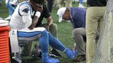 Carolina Panthers quarterback Cam Newton (1) receives attention on the sideline after an injury in the first half of an NFL preseason football game against the New England Patriots, Aug. 22, 2019, in Foxborough, Mass. (AP Photo/Charles Krupa)