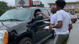 Local teen registers people to vote as they wait in line at Popeyes