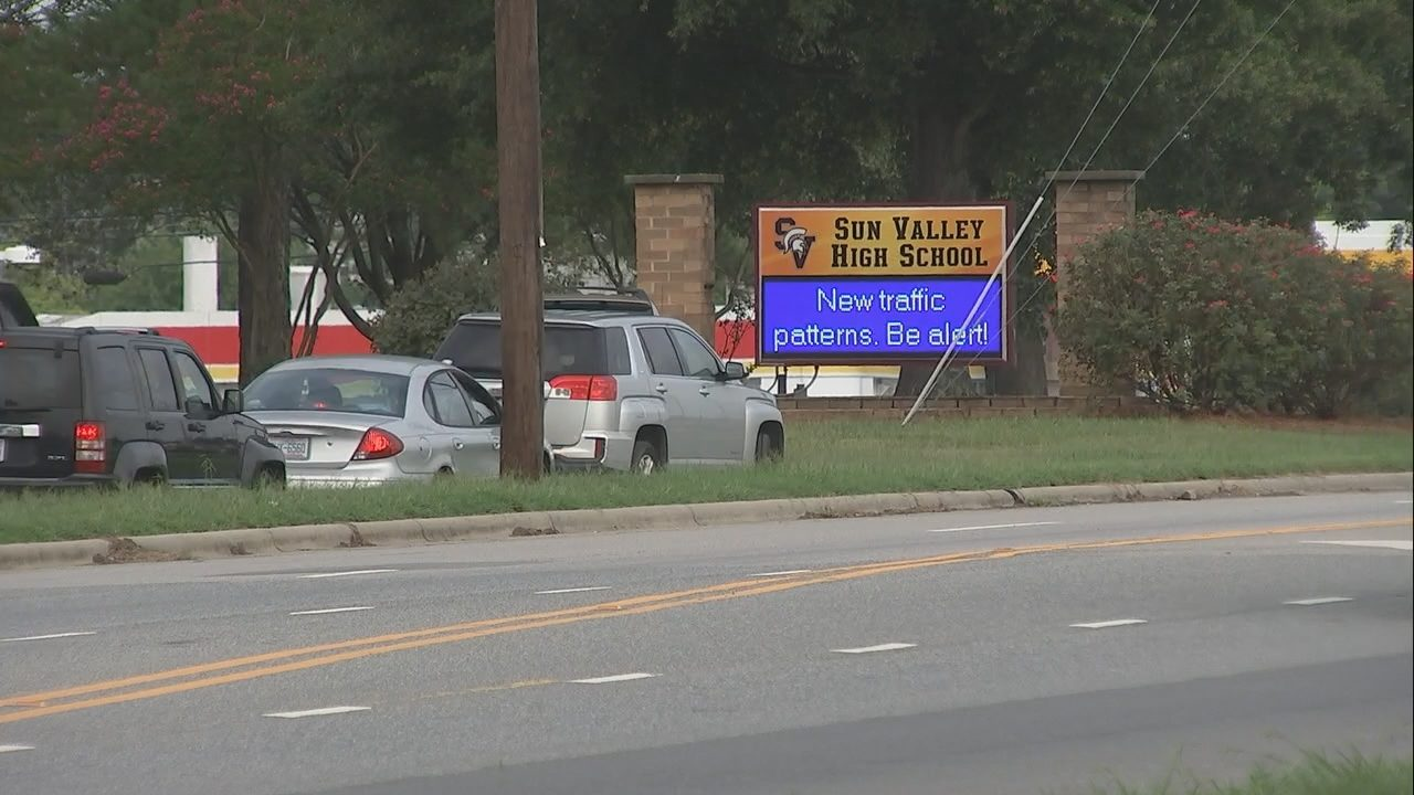 Student taken into custody after principal spots gun in back